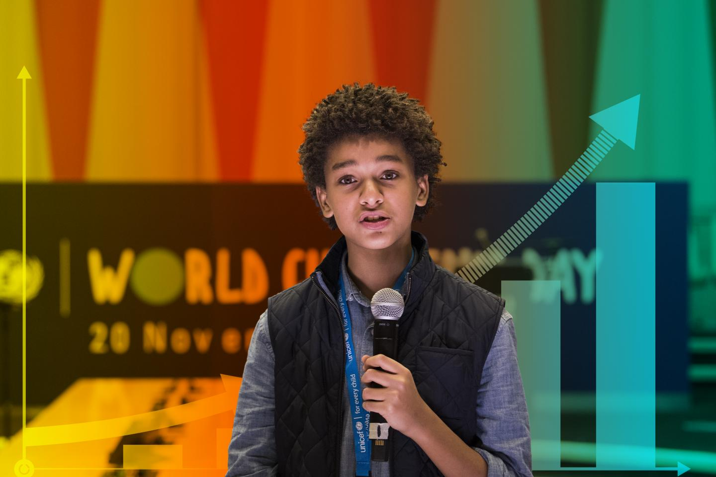 Jaden Michael, a young actor, speaks into a microphone at an event for World Children's Day.