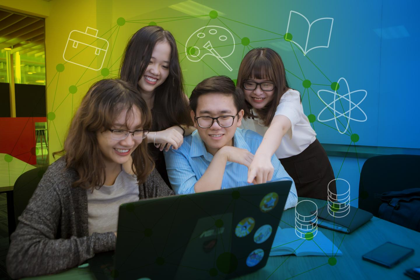 Four young people collaborate at a laptop computer in Viet Nam.