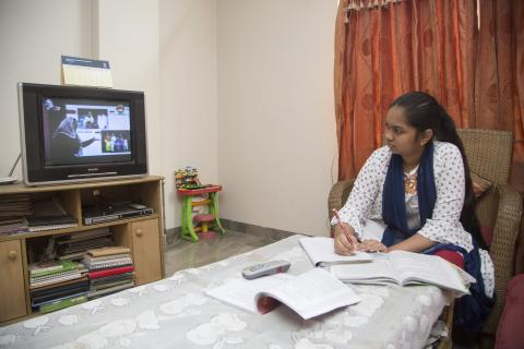 A young Bangladeshi girl is seen studying from home during the COVID-19 pandemic.