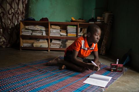 Hussaini, 14, listens to educational lessons broadcast as part of the Radio Education in Emergencies programme in Dori, Burkina Faso.