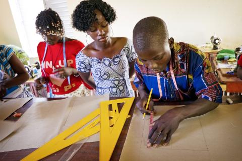 A student measures shapes at a class in Burkina Faso.