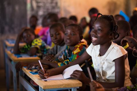 Nabyla (right), 13, attends class in Kaya, Burkina Faso, the town in which her family found refuge after being displaced.