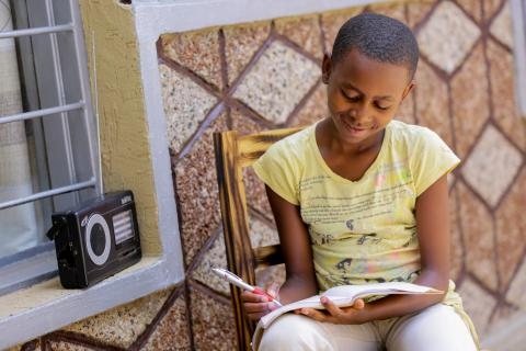 Umuhoza Dative, 11, Rwanda, studies at home due to coronavirus-related school closures, listening to her Primary 6 lessons on the radio every day.