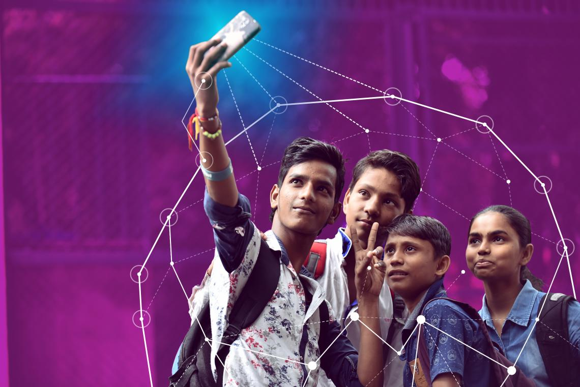 Four young people pose for a selfie in India.