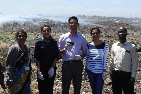 A team of young people stands at a waste disposal site in Kenya..