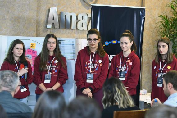 Five young women present their ideas to judges at the Youth Challenge in Kosovo.