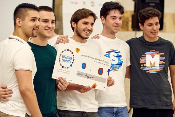 A team of young accept their award at the Generation Unlimited Youth Challenge in Montenegro.