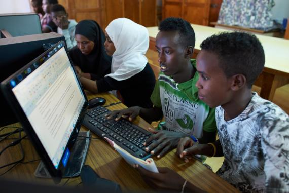 Youth work together at a inclusive computer education class at the LEC of Ali-Sabbieh in Djibouti.