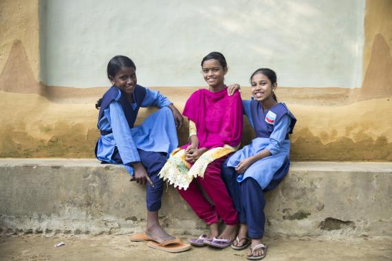 Nilima Das (Middle), is passing time with her classmates in front of her house. Lakkatura Tea state. Sylhet. Bangladesh.